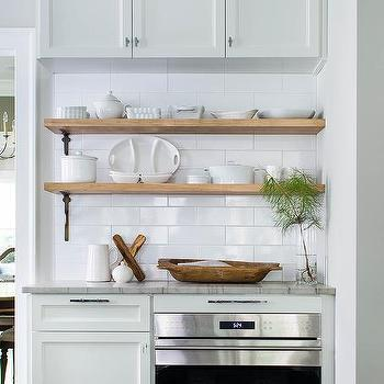 sage green kitchen features sage green cabinets paired with white