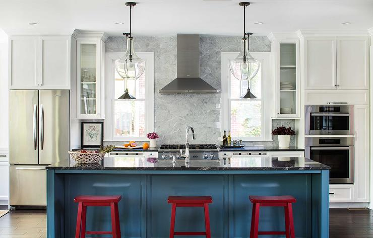 blue kitchen island with red sawhorse stools