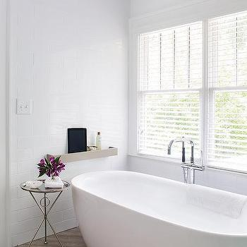 White Bathroom With Gray Herringbone Tile Floor