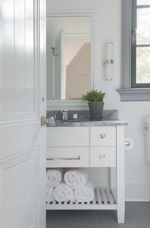 White And Gray Bathroom Features A Freestanding White Washstand With Shelf  Topped With Gray Stone Under A Framed Inset Medicine Cabinet Alongside A  Gray ...