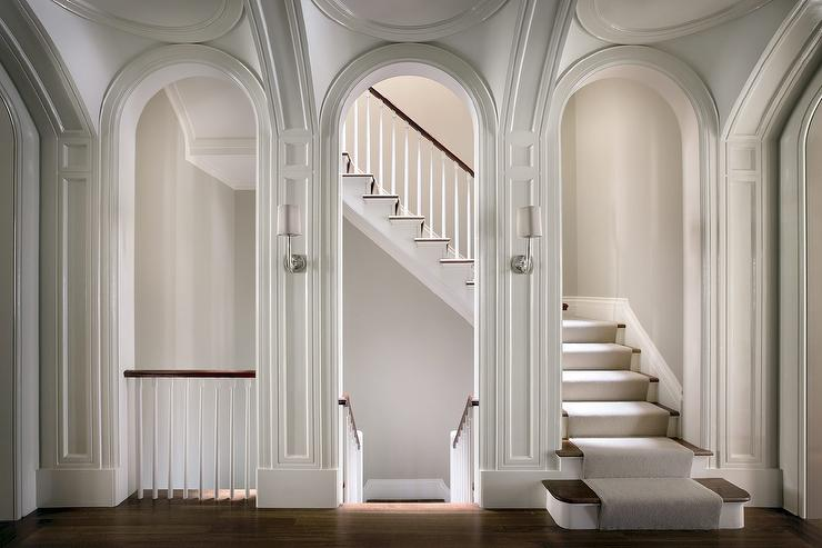Arched Staircase Doorway With Sconces