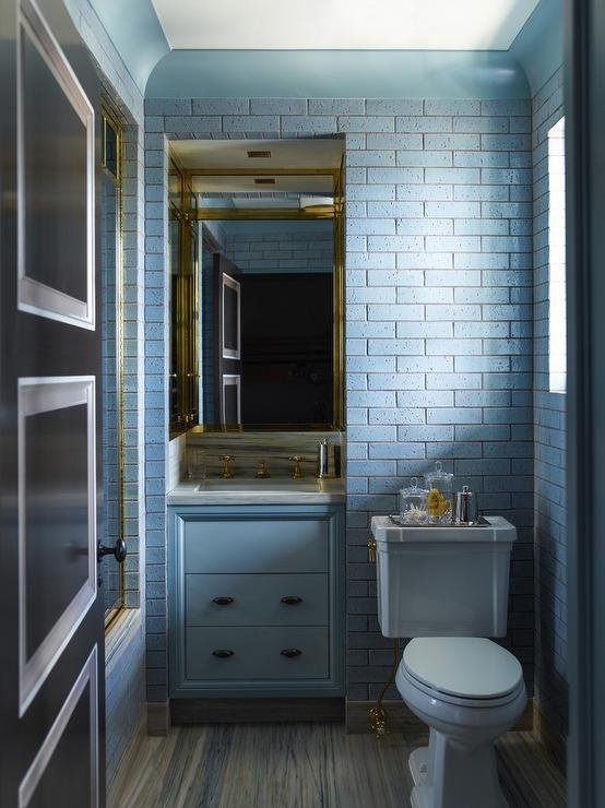 Blue bathroom with brick tiles contemporary bathroom for Blue and gold bathroom sets
