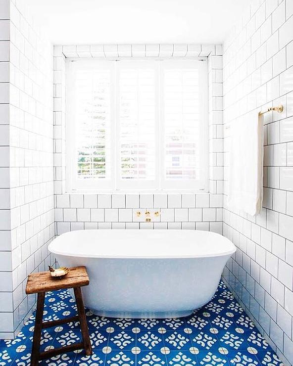 White bathroom with blue mosaic floor tiles transitional for Blue mosaic bathroom accessories