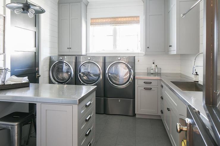 light gray laundry room cabinets with stainless steel countertops a Laundry Room