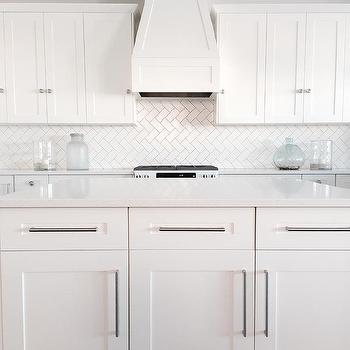 All White Kitchen with Herringbone Backsplash