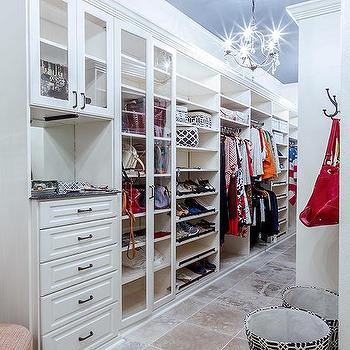 Long Walk In Closet With Blue Painted Ceiling