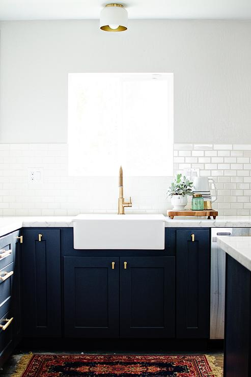 Navy Shaker Kitchen Cabinets With Brushed Brass Knobs