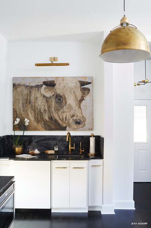 Eclectic Kitchen Boasts White Flat Front Cabinets Adorned With Gold