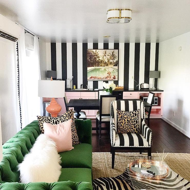 Black And White Striped Walls With Emerald Green Tufted