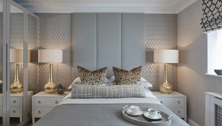 Gold And Gray Bedroom Features An Accent Wall Clad In David Hicks Hexagon  Wallpaper Lined With A Gray Padded Headboard On Bed Dressed In White And  Gray ...