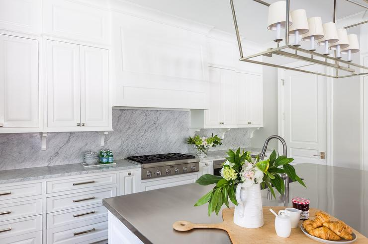 Kitchen Cabinet Corbels With Marble Backsplash