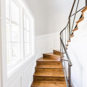 Narrow Winding Staircase With Paneled Walls