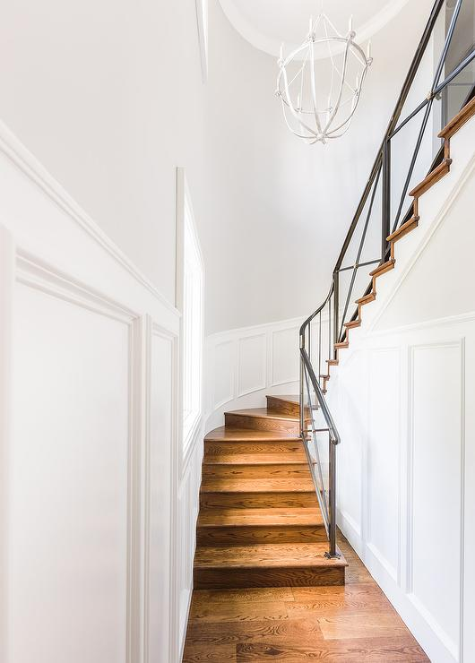 Winding Staircase With Wainscoting Walls