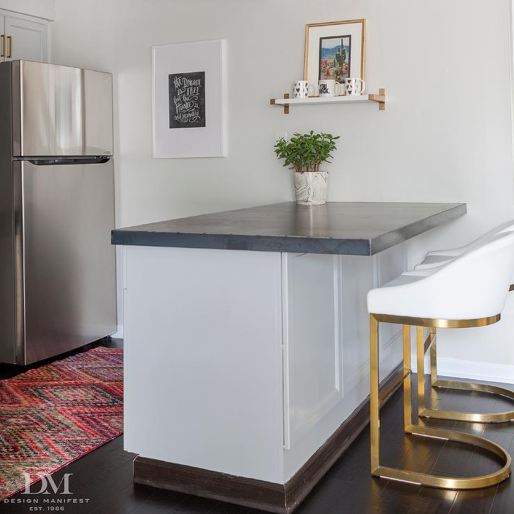 Gray Kitchen Peninsula With White And Gold Stools