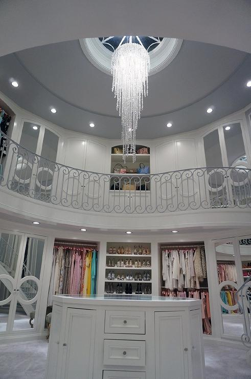Stunning Two Story Closet Features A Staircase Leading Up The Second Floor  Fitted With Mirrored Closet Doors And Shelves Lined With Designer Bags.