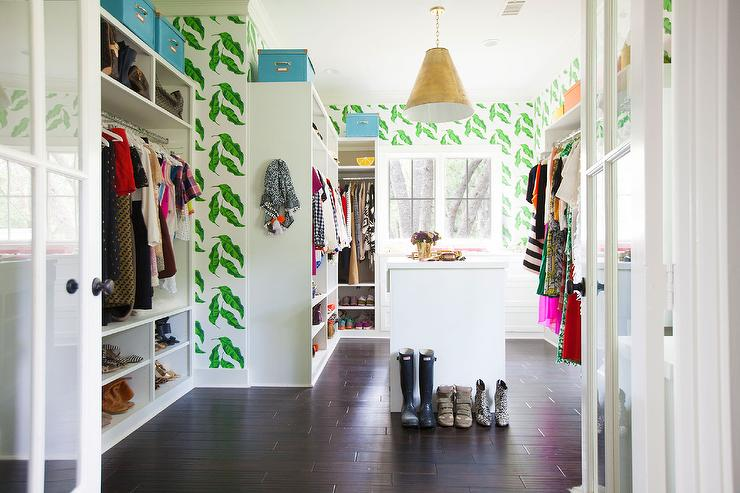 Chic Walk In Closet Features Walls Clad Leaves Wallpaper Lined With Built Open Wardrobe Cabinets And Shelves
