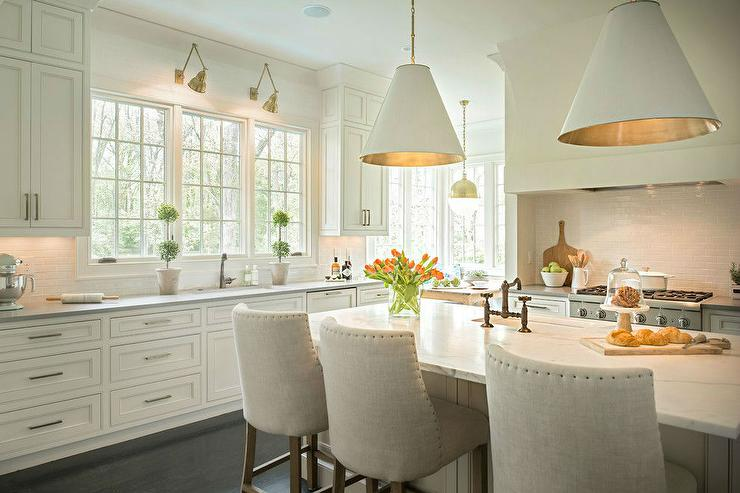 Island with white leather barrel back counter stools for Show me beautiful kitchens