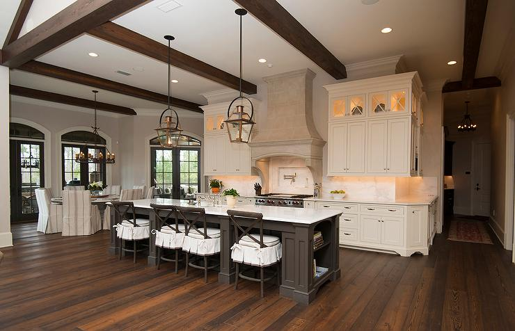 ... gray kitchen island fitted with end cookbook shelves topped with  contrasting white marble lined with dark gray French cafe counter stools  accented with ... - Skirted Counter Stools Design Ideas