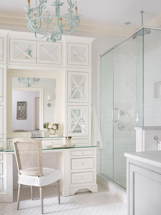 Ivory mirrored vanity cabinets arabesque tile floor turquoise chandelier
