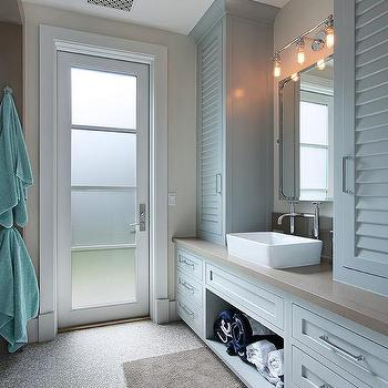 Blue Bathroom Cabinets With River Rock Floor