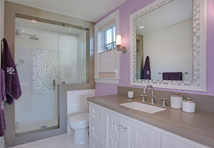 Purple girls bathroom with mosaic tile mirror for Bathroom photos of ladies