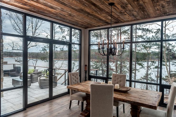 Contemporary cabin dining room with floor to ceiling for Floor to ceiling windows