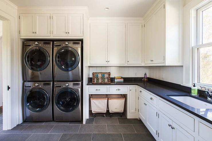 Contemporary Laundry Room With Two Sets Of Stacked Washers