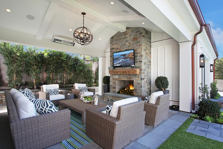 Light Teak Outdoor Sofas With Blue Pillows Transitional