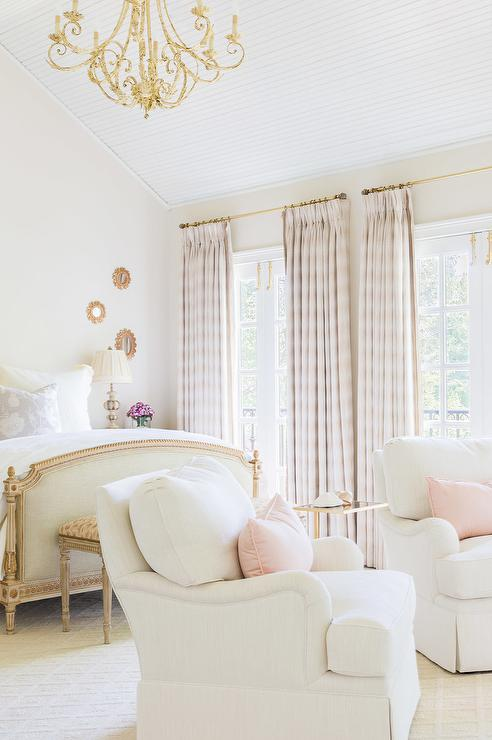 Alyssa Rosenheck   White And Pink French Bedroom Features A High Vaulted  Ceiling Accented With A Gold Chandelier Illuminating A French Bed With  Headboard ...