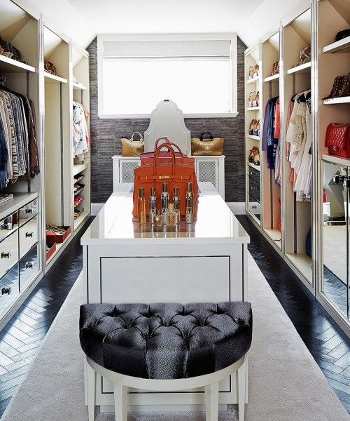 Walk In Closet With Black Tufted Half Moon Bench