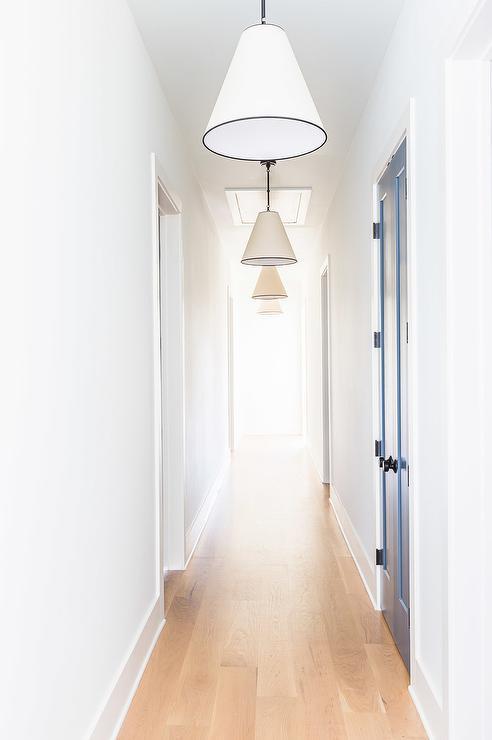 & Alyssa Rosenheck: Long Hallway with Blue Closet Doors