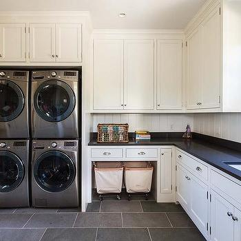 Cottage Laundry Room With Stacked Washers And Dryers
