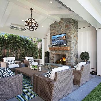 Patio with sleek fireplace and hearth cottage deck patio for Covered porch with fireplace