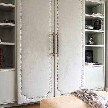 Gray Fabric Padded Closet Doors With Silver Nailhead Trim