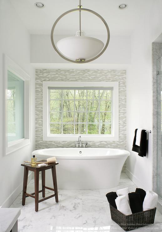 bathroom with gray glass tile accent wall contemporary