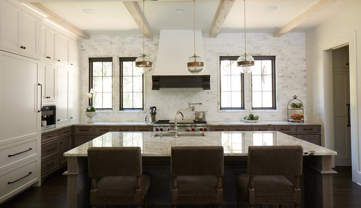 Awesome White And Brown Kitchen Features White Upper Cabinets And Brown Distressed  Lower Cabinets Paired With Fantasy Brown Granite Countertops And A Linear  Marble ...