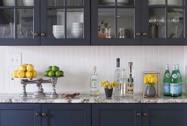 Fantastic kitchen features navy navy blue cabinets paired with white