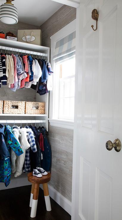 Faux Bois Wallpaper nursery closet with nobilis faux bois wallpaper - transitional