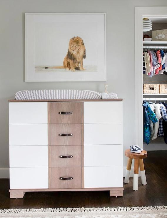 Amazing Nursery Features A Two Tone Dresser Changing Table Adorned With  Brown Leather Straps, Ducduc Morgan Changer, Topped With A Gray Striped  Changing Pad ...