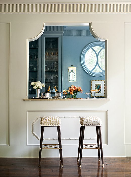 A Blue Kitchen Is Fitted With A French Pass Through Lined With A Pair Of  Taupe Maze Barstools.