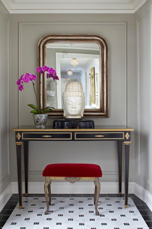 Foyer Table With Stools : Red velvet stool tucked under a black and gold console