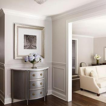 gray half moon console table with gold trim and marble top