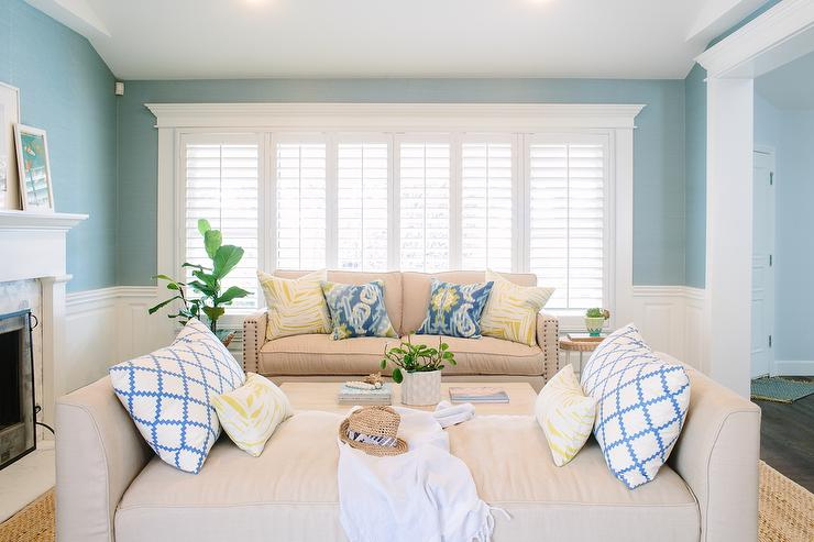 Elegant Beige And Blue Living Room With Wainscoting
