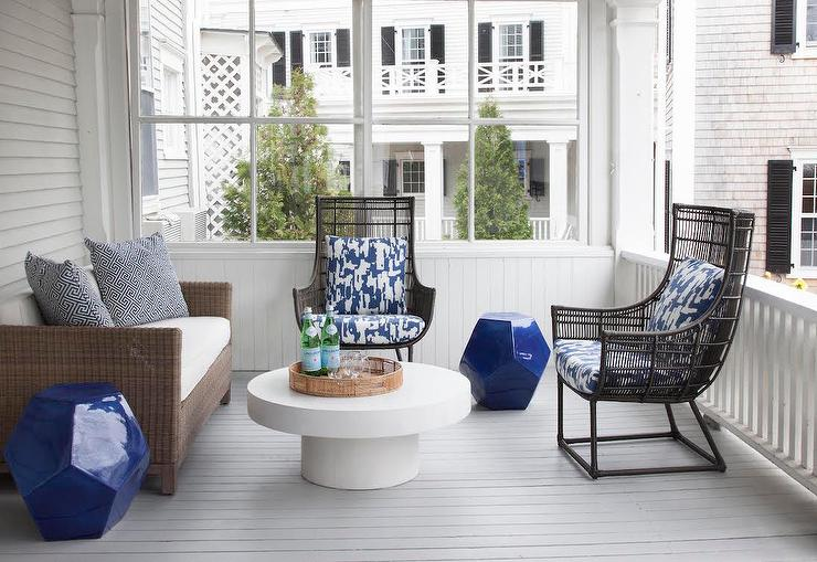 Contemporary Sunroom With Round White Cocktail Table