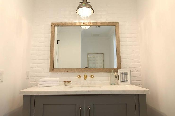Cottage Bathroom With White Exposed Brick Wall