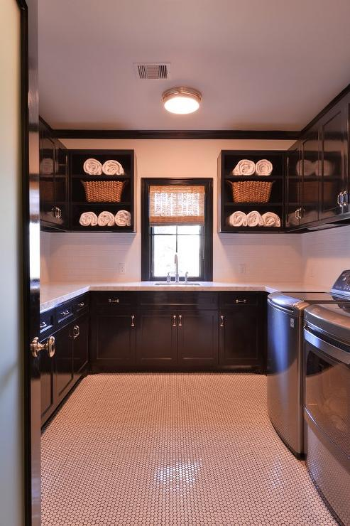 Glossy Black Laundry Room Cabinets With White Marble