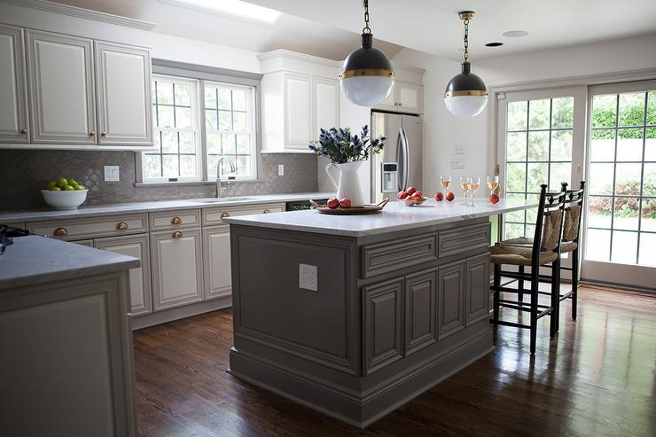 Gray and white kitchen features a white kitchen island topped with a white  marble countertop seating