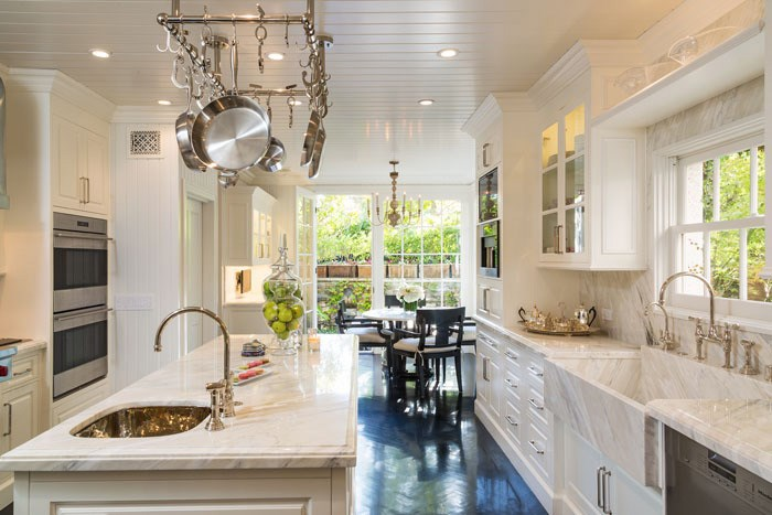Gorgeous Kitchen Features A Beadboard Ceiling Dotted With Pot Lighting And  A Stainless Steel Pot Rack Suspended Over A Long And Narrow Kitchen Island  Topped ...