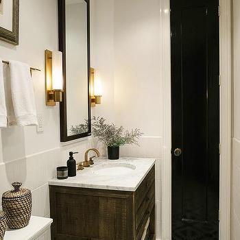 Narrow Bathroom With Black Linen Closet Door