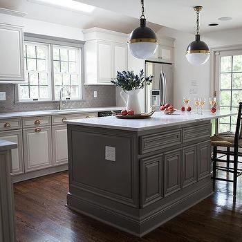 gray kitchen island with black rush seat bar stools